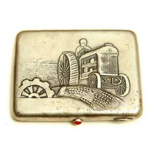 The Soviet cigarette case silver with a picture of a tractor, 1943