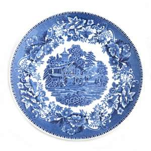 Plate with decorative rustic plot