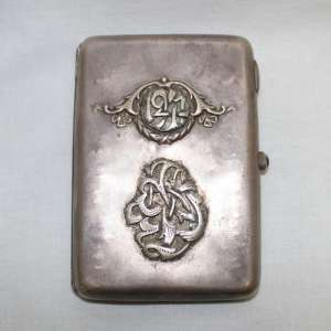 Silver cigarette case is decorated with