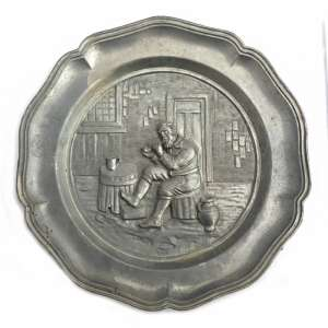 The brass plate with the image of men