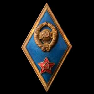 Badge (diamond-shaped) on the end of a military Academy
