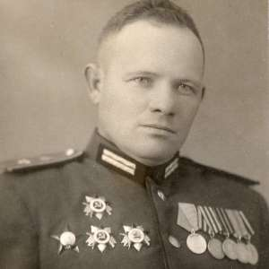 Photos officer red army with three orders of the Patriotic war