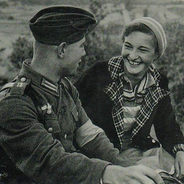 "Postcard of ""soldiers of the 13th regiment of the Wehrmacht with a girl"""